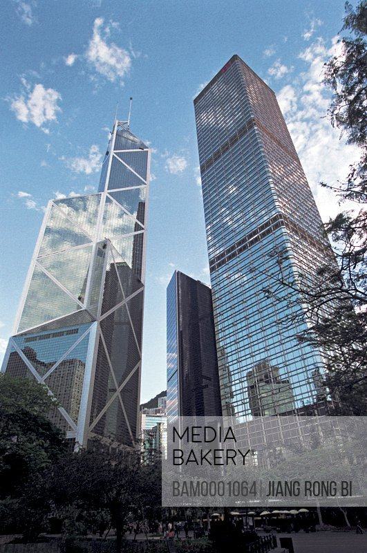 Low angle view of buildings against blue sky, The high-rise bank of china perch inside in Hongkong, Hongkong special administration region of People's Republic of China