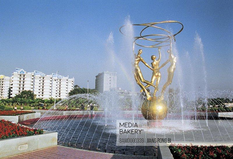 Fountain with golden statues, Sculptures in Jiangbin park, Fuzhou City, Fujian Province, People's Republic of China