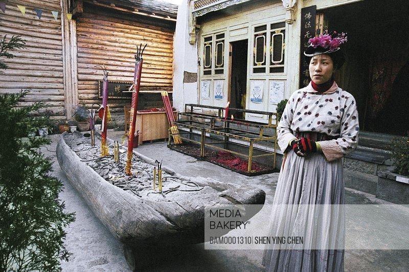 Young woman wearing traditional clothing, Shuttle female of Luguhucun, Lugu Lake, NingLang County, Lijiang City, Yunnan Province of People's Republic of China