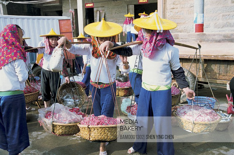 Huian Woman in Xiaozuo Village are selling fish, Xiaozuo Village, Huian County, Fujian Province of People's Republic of China