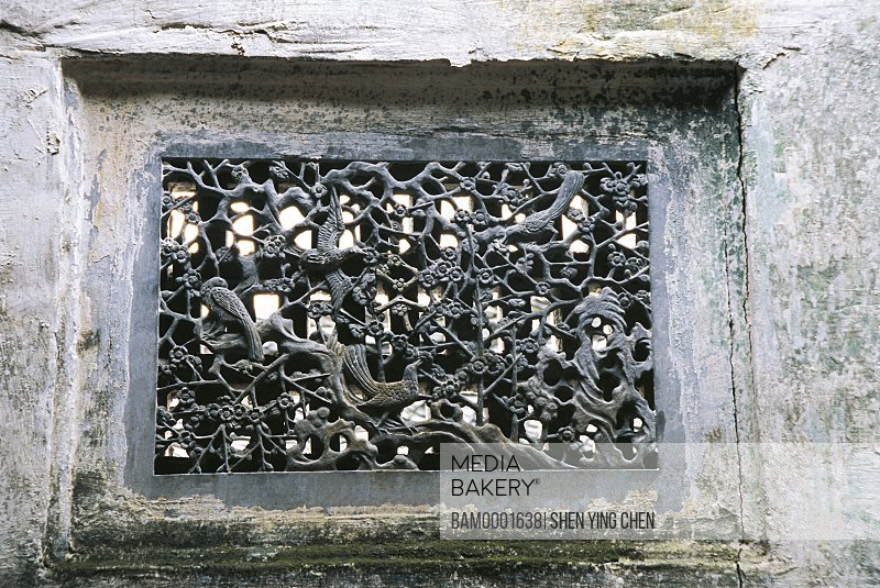 Close-up of carved window, The windows of Ming and Qing dynasty's ancient common people residence of Hong Village, Hong Village, Yi County, Anhui Province of People's Republic of China