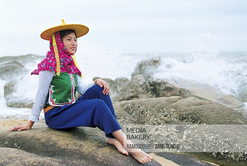 Girl sitting on rock by sea, Attractive Huian Ladies on Beach, Chongwu Town, Huian County, Fujian Province, People's Republic of China