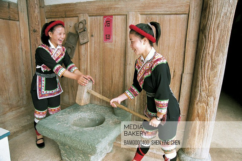 View of young women working at house, She race custom performance in the folk custom character and style garden, Rixi Township, Jinan District, Fuzhou City, Fujian Province of People's Republic of China