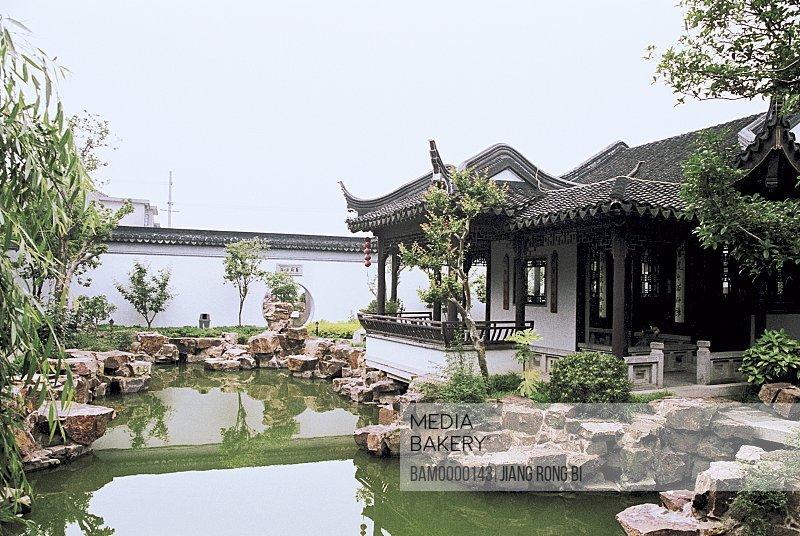 View of a house by a pond, Yanjia garden in old Mudu Town, Mudu Town, Suzhou City, Jiangsu Province of People's Republic of China