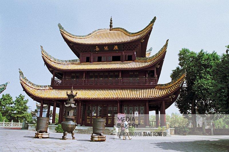 Man and woman walking by Yueyanglou, near the Dongting Lake, Yueyang City, Hunan Province, People's Republic of China