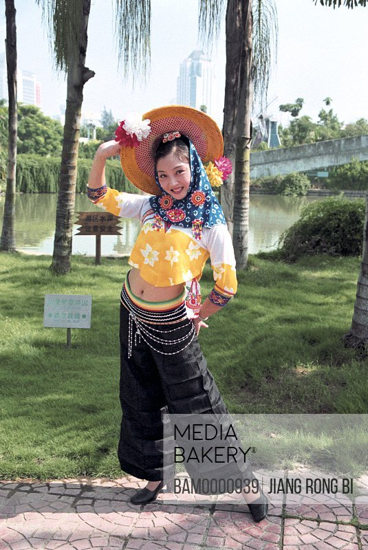 Portrait of a smiling teenage girl with hat on head, Hui'an women at the photographic exhibition often Taiwan strait, Fuzhou City, Fujian Province, People's Republic of China