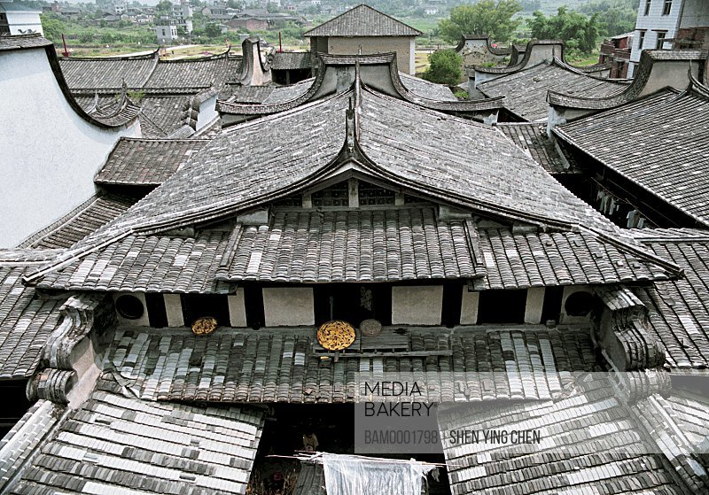 Elevated view of dried maize corns on roof, Building frame of Great Lin places, Great Honglin Places, Mingqing County, Fujian Province of People's Republic of China