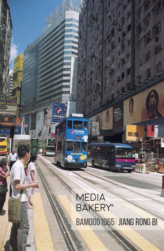 Trams moving on road, The street area of Hongkong contain the tramcar, Hongkong special administration region of People's Republic of China