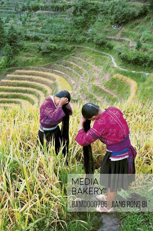 Hongyao minority long hair girl combing in Longji mountain, Longsheng County, Guilin City, Guangxi Zhuang Nationality Autonomous Region of People's Republic of China