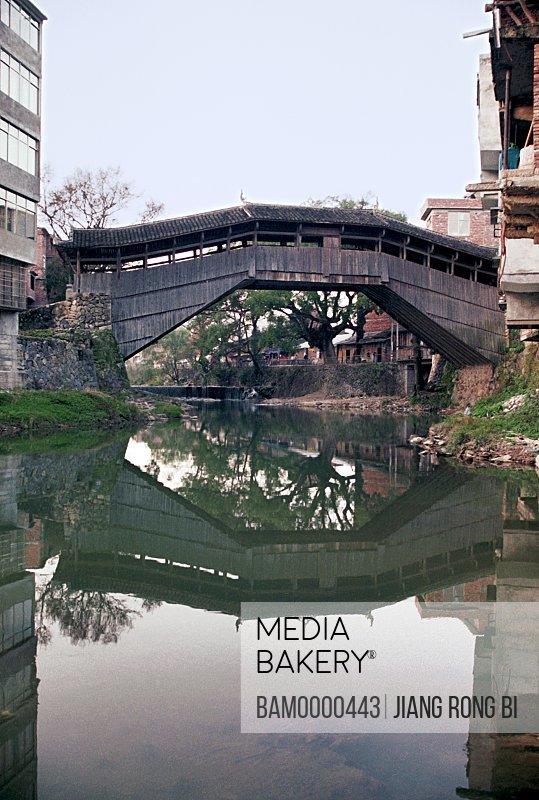 Lake by buildings, Xue's Bridge Built in Qing Dynasty in Taishun, Taishun County, Zhejiang Province, People's Republic of China