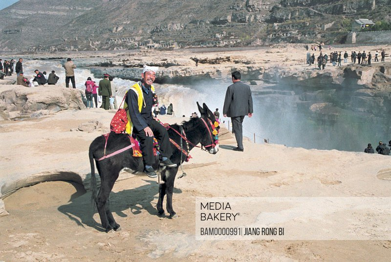 North Shanxi's Old Man on Donkey at Hukou Scenic Spot , Yichuan County, Yan'an City, Shanxi Province, People's Republic of China
