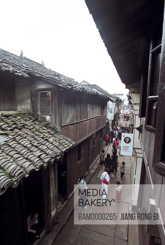 People walking in lane amid shops, Age-old Lanes in Wuzhen Town, Tongxiang City, Zhejiang Province, People's Republic of China
