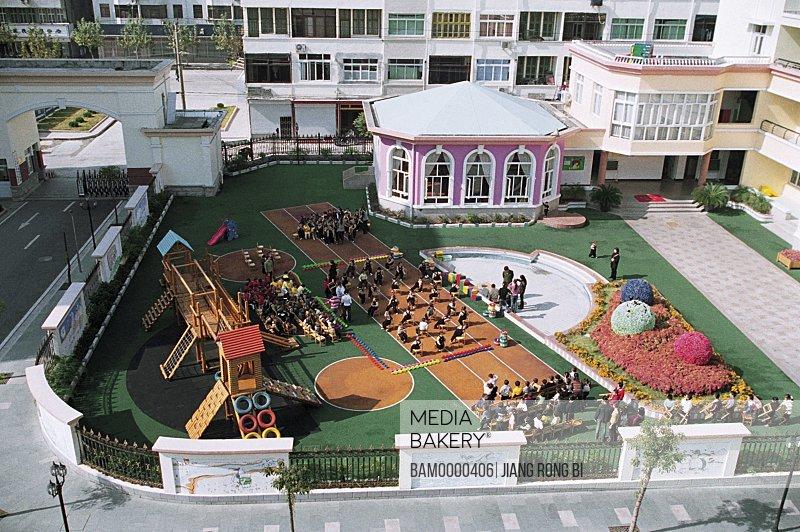 Elevated view of children playing in school, Yongchang County Kang'aiyuan Kindergarten , Yongchang County, Wenzhou City, Zhejiang Province, People's Republic of China