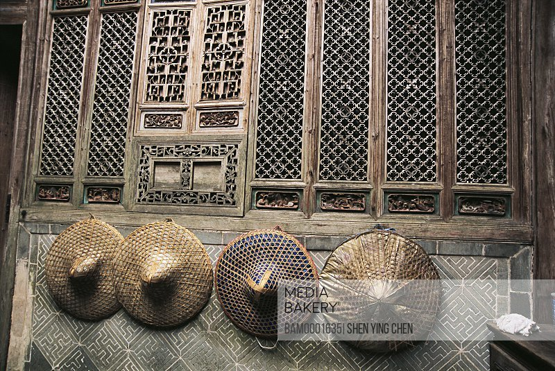 Hats hanged on wood carved wall, Lu Village's ancient common people residence of Ming and Qing dynasty, Lu Village, Yi County, Anhui Province of People's Republic of China