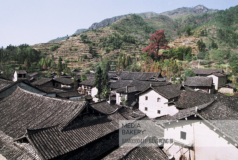 Elevated view of houses with mountains in background, Ancient Residence in Taishun, Taishun County, Zhejiang Province, People's Republic of China