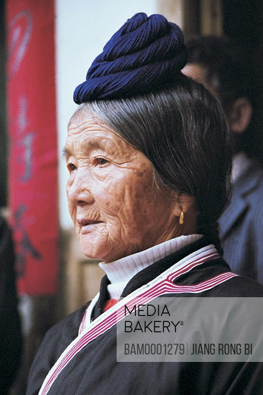Close-up of a senior woman at wedding ceremony, She Nationality Elders on Wedding Ceremony, Huokou Township, Luoyuan County, Fuzhou City, Fujian Province, PRC