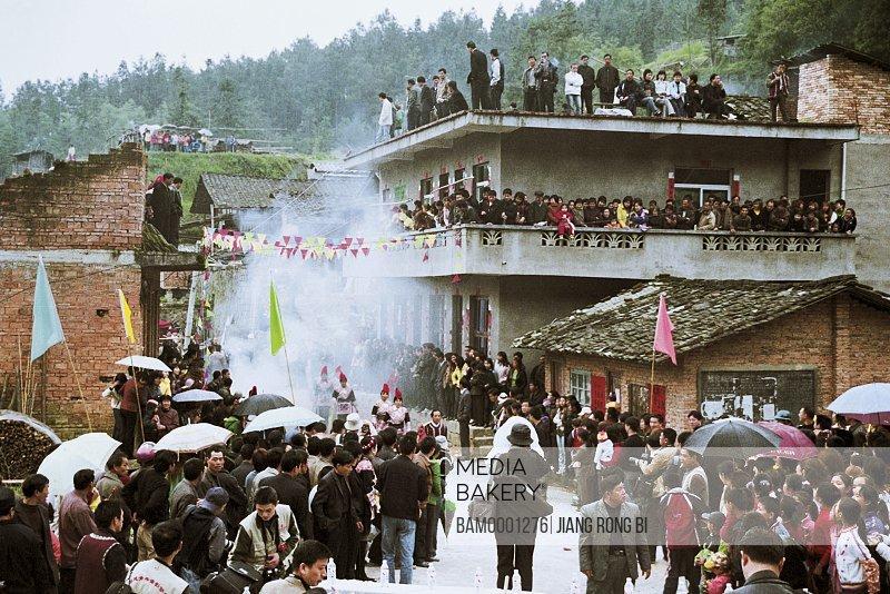 People celebrating on road, Folk Custom of She Nationality on March 3rd, Huokou Township, Luoyuan County, Fuzhou City, Fujian Province, PRC