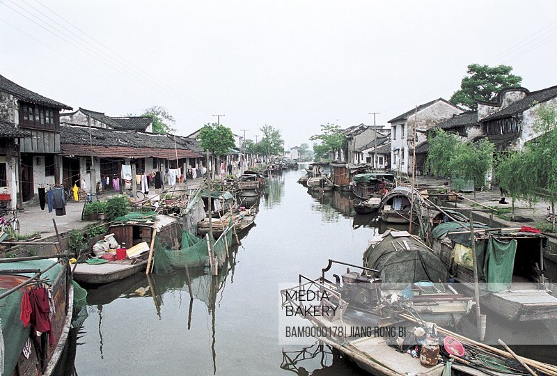 View of houses by river, Black Roof Boat in Xitang Town, Jiaxing City, Zhejiang Province, People's Republic of China