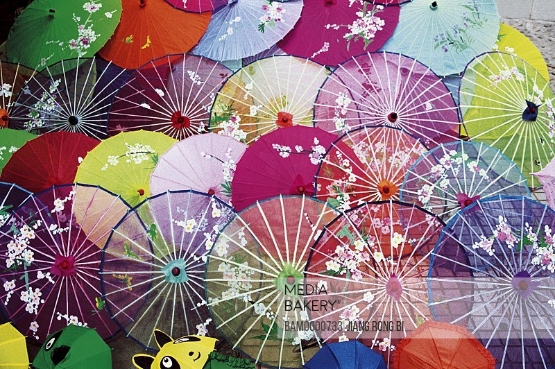 Elevated view of colorful umbrellas, The small flower umbrella sells in the park of forest, Fuzhou City, Fujian Province, People's Republic of China