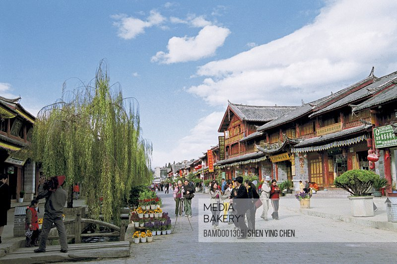 People walking on street, Historic building of old Lijiang city, Lijiang old city, Yunnan Province of People's Republic of China