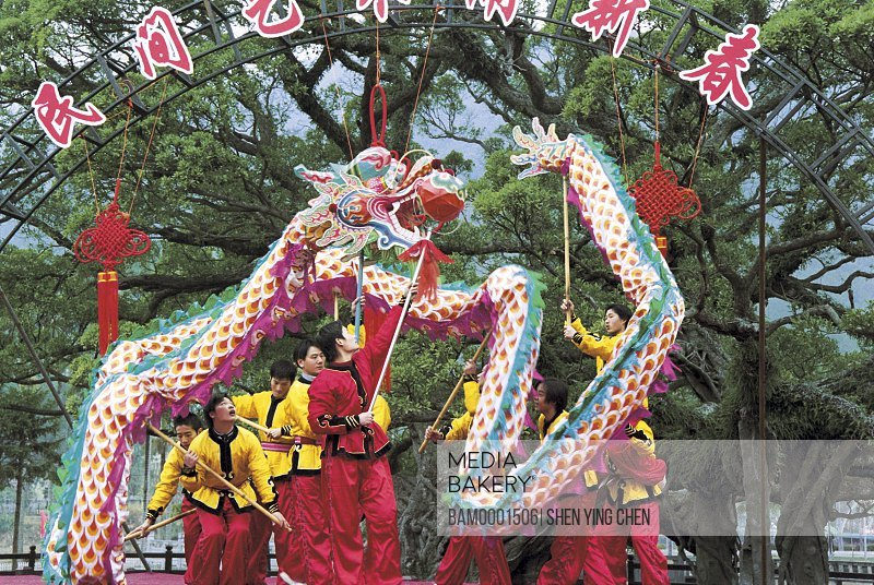 Men in traditional costumes performing on stage during a festival, Winter jasmine folk art performance in country forest park---Drgon dance, Fuzhou City, Fujian Province of People's Republic of China