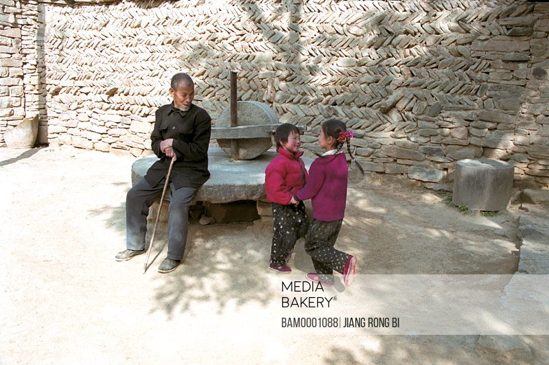 Elders and Kids beside Stone Roller , Yichuan County, Yan'an City, Shanxi Province, PRC