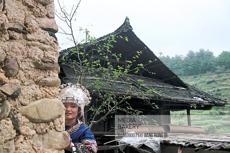 Miao minority girls wear the national clothing, Thousand of Miao minority's house of Xijiang, Kaili City, Guizhou Province of People's Republic of China