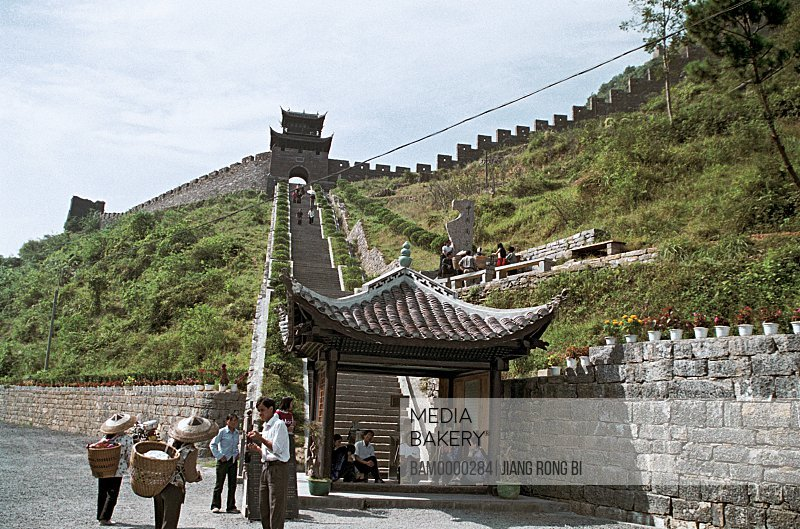 Tourists standing near great wall of china, The southern Great wall built in the Qing dynasty, Fenghuang, Xiangxi Prefecture, Hunan Province, People's Republic of China