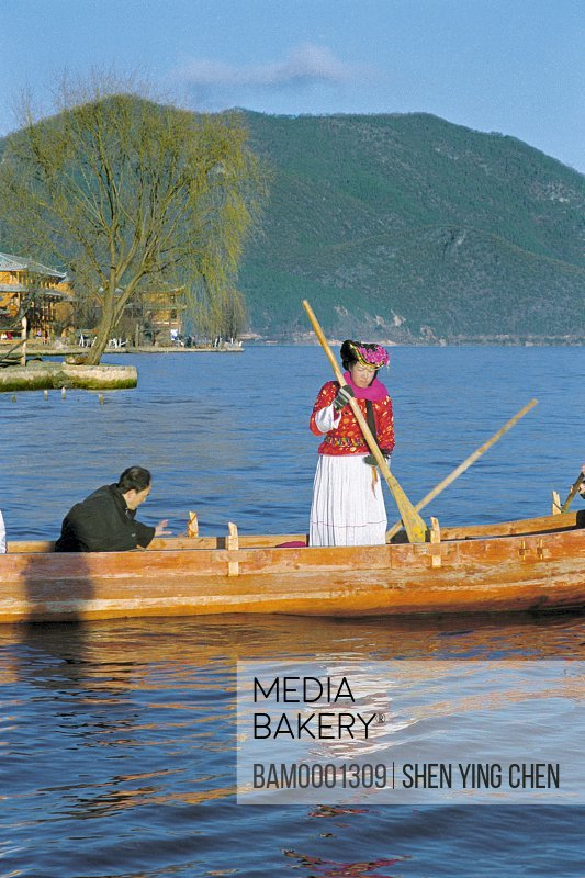 People traveling in boat, Pig junk boat on the Lugo Lake, Lugu Lake, NingLang County, Lijiang City, Yunnan Province of People's Republic of China