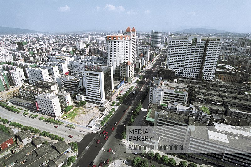 Cityscape with mountains in background, Wuyi south street of Fuzhou City, Fuzhou City, Fujian Province of People's Republic of China