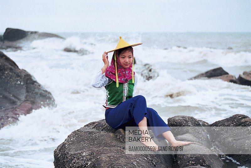 Girl sitting on rock by sea, Attractive Huian Ladies on Beach, Chongwu Town, Huian County, Fujian Province, People's Republic of China