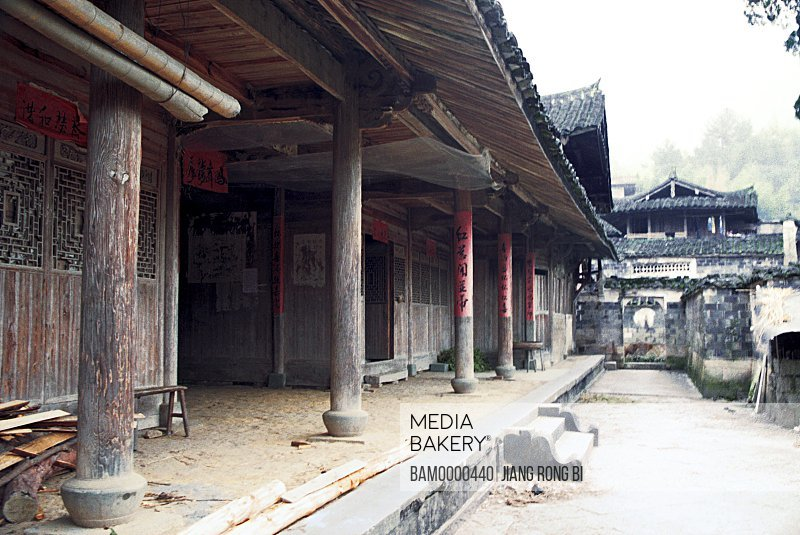 View of house with Chinese text on pillar, Small Courtyard of Ancient Residence, Taishun County, Zhejiang Province, People's Republic of China