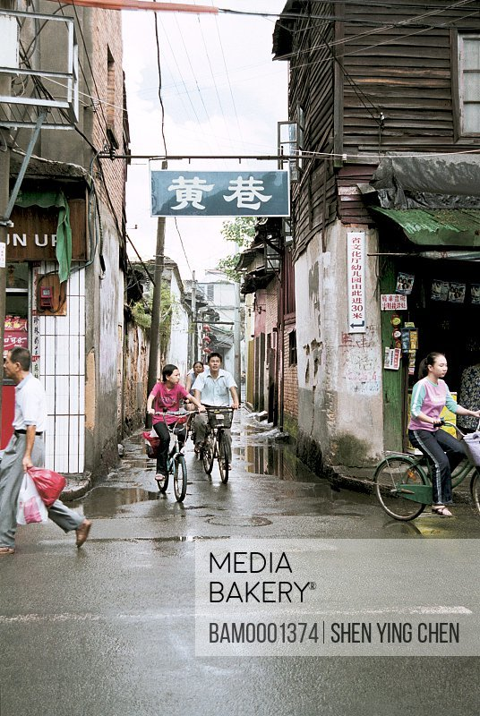 People riding bicycles on lane, Three work place seven lanes---Huang lane, Huangxiang entrance, Back South street, Fuzhou City, Fujian Province of People's Republic of China