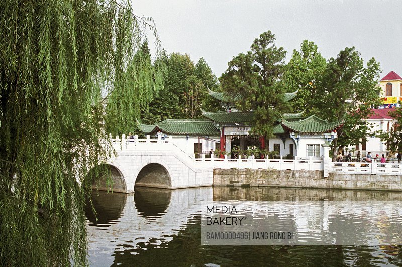 View of bridge over lake, Scenery of Cuihu Park, Kunming City, Yunnan Province, People's Republic of China