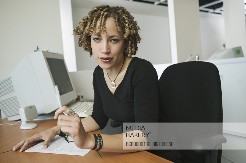 A woman working at her desk.