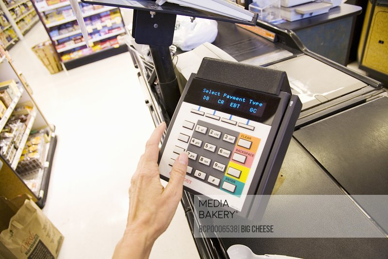 Person using debit card transaction machine