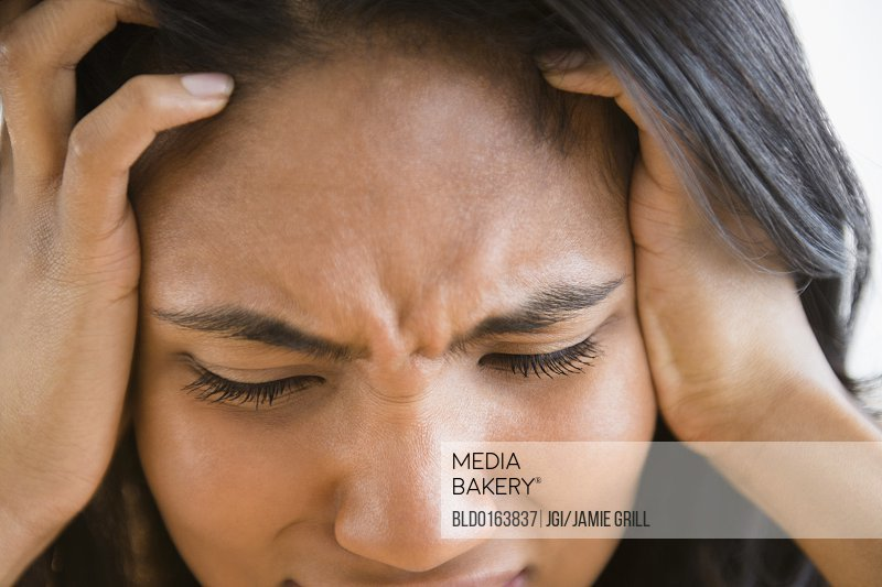 Mixed race woman thinking