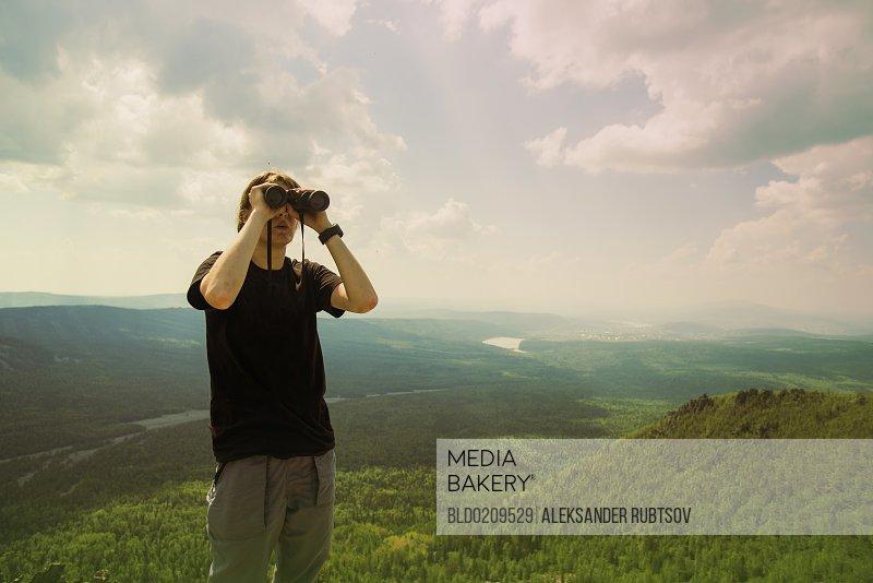 Caucasian hiker admiring remote landscape