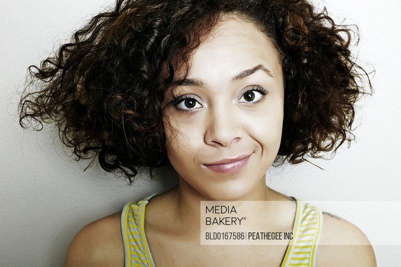 Mixed race woman smirking