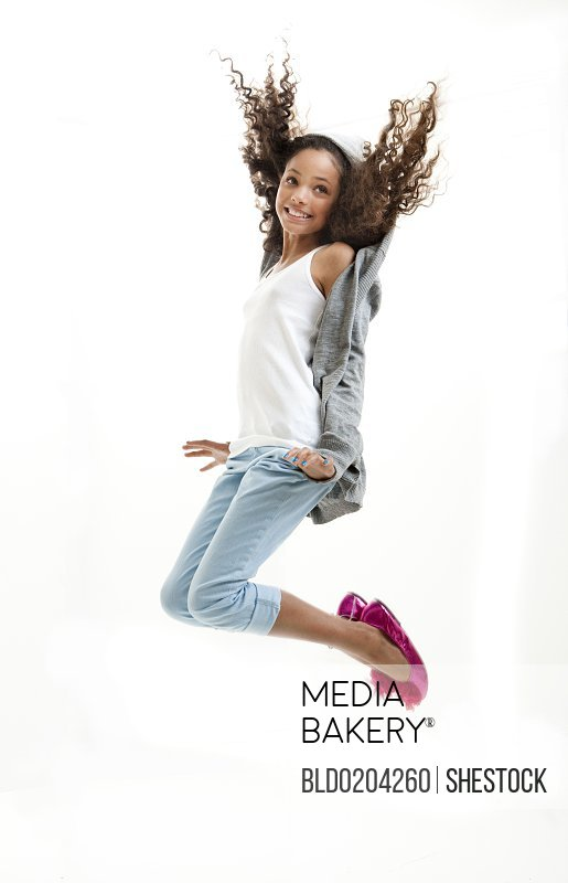 Mixed race girl jumping for joy