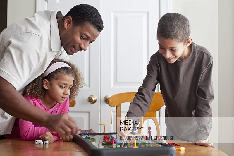 Family playing board game together