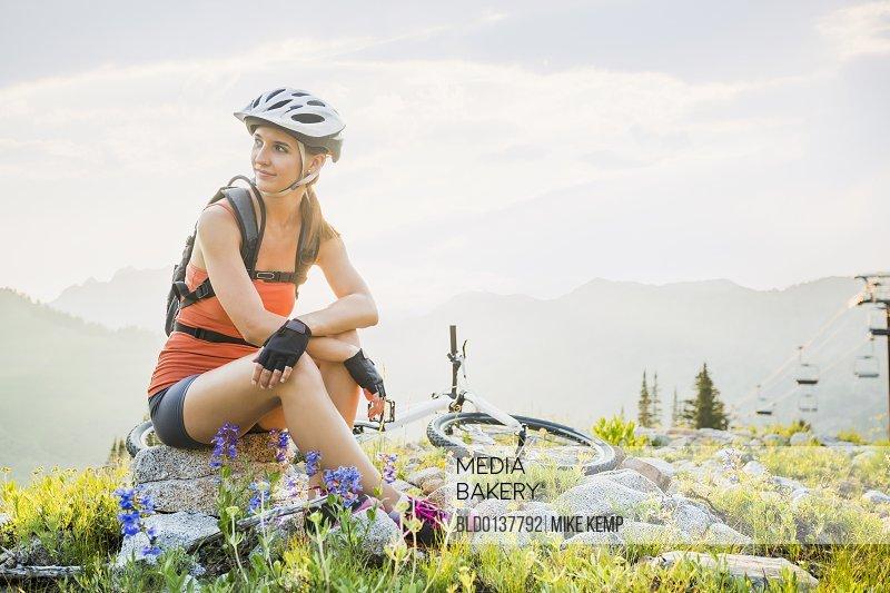 Caucasian woman sitting near mountain bike