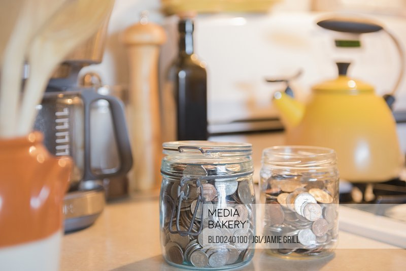 Jars Of Coins On Kitchen Counter