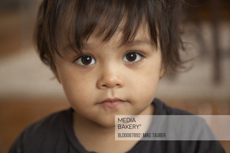 Serious mixed race boy