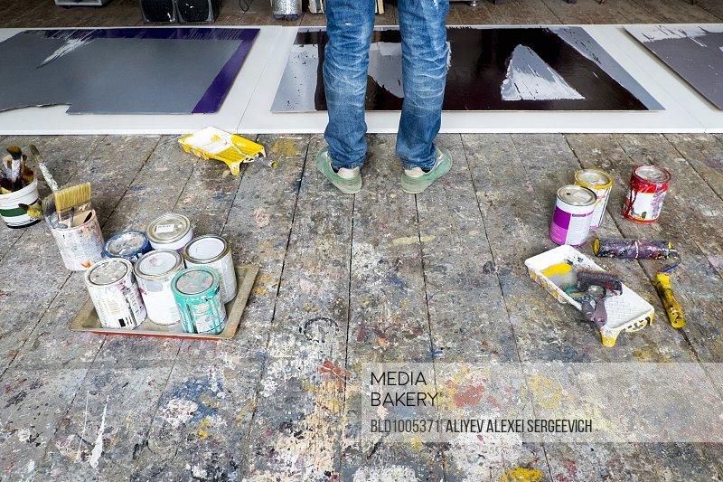 Caucasian artist painting in art studio
