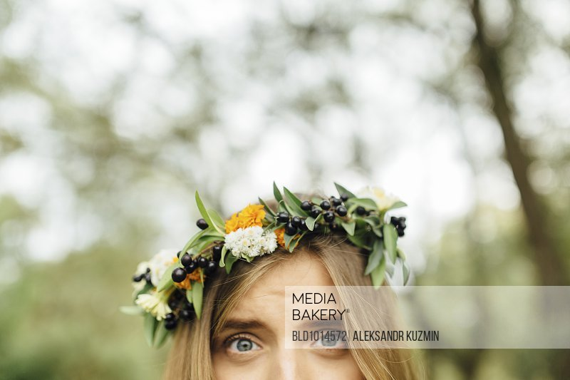 Eyes of Middle Eastern woman wearing flower crown