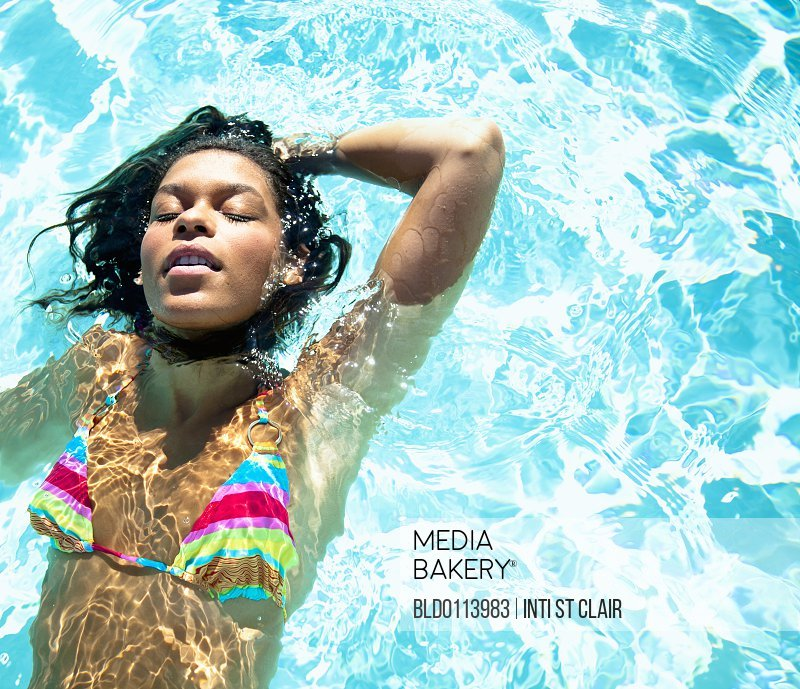 dfcc629f52f Mediabakery - Photo by Blend Images - Mixed race woman swimming in ...