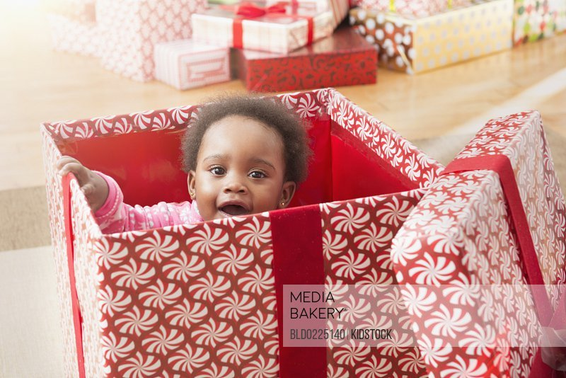 Mediabakery - Photo by Blend Images - Black baby girl playing in ...