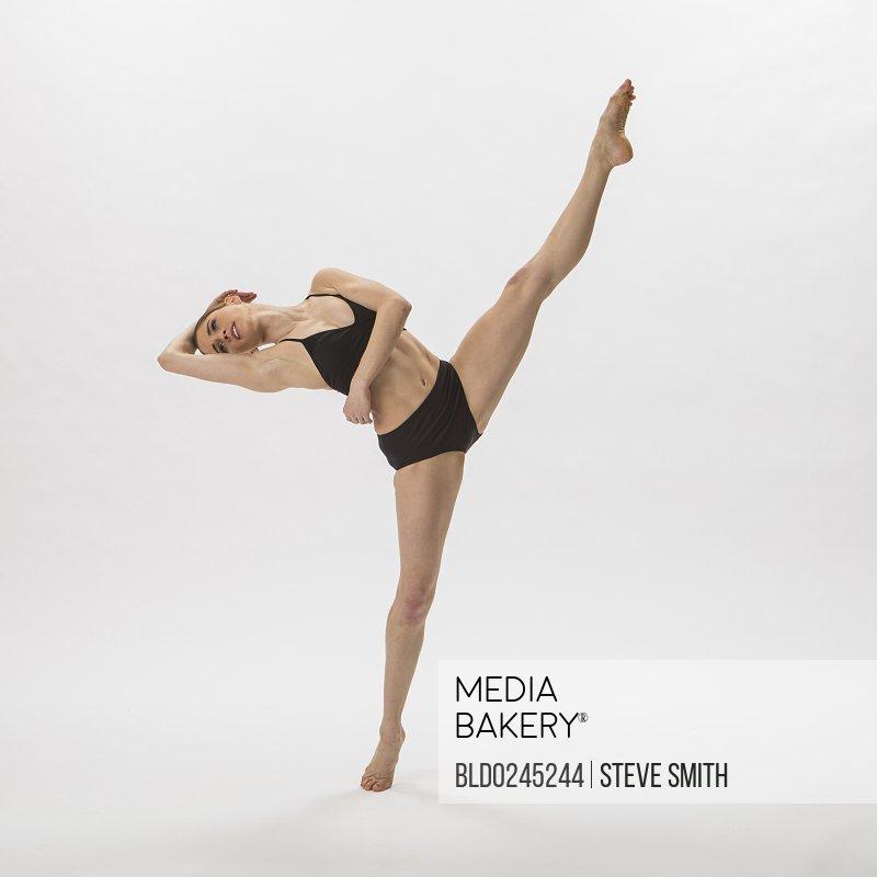 Caucasian woman ballet dancing in underwear