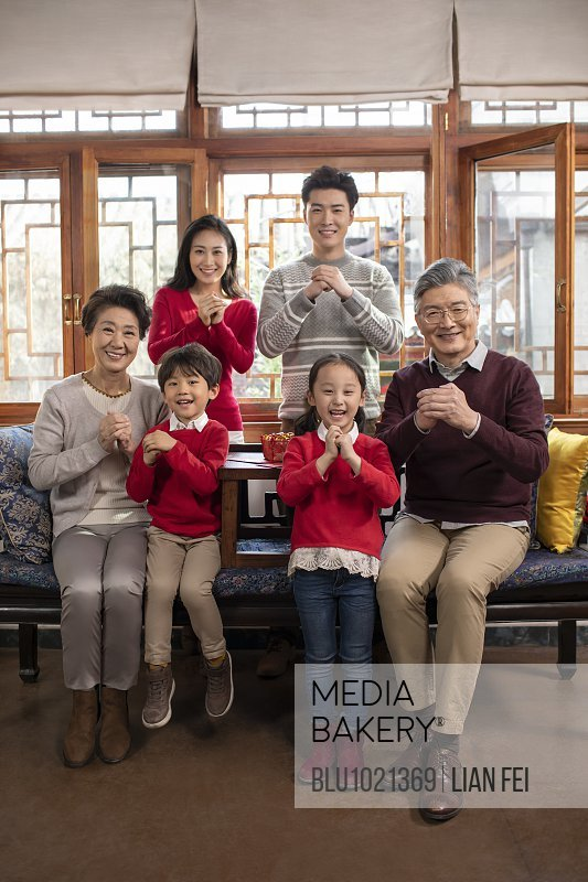 Happy family celebrating Chinese New Year